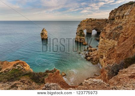 Arch Beach Marinha, Portugal. The waves on the shore.