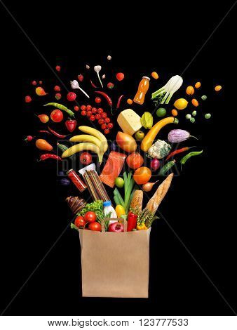 Deluxe food in package. Studio photography of different fruits and vegetables isoleted on black background top view.