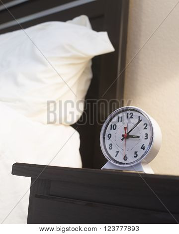 Old Fashioned alarm clock set for early morning hour.