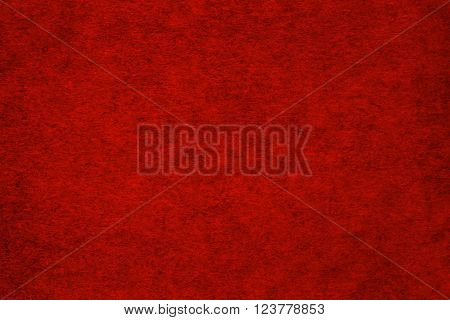 Deep red spotted paper texture or background