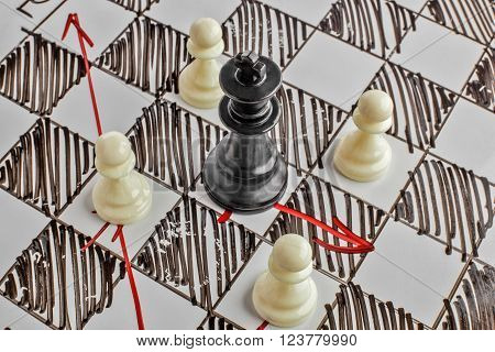 Chess. The black King is under attack. White board with chess figures on it. Helpmate or checkmate.