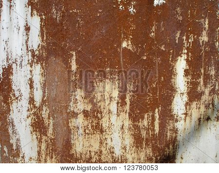 Old cracked paint on the wall. Grunge rusty texture. Grunge metal background. Retro texture. Vintage texture. Peeling paint. Distress Texture. Scratched wall pattern