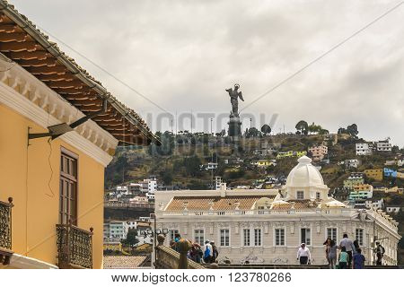 QUITO ECUADOR OCTOBER - 2015 -Low angle view of colonial classic style buildings and the famous panecillo hill at background at the historic center of Quito in Ecuador.