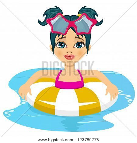 Portrait of happy child girl swimming in pool on inflatable ring