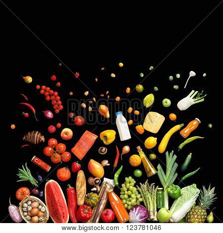 Deluxe food background. Studio photo of different fruits and vegetables isolated on black background top view