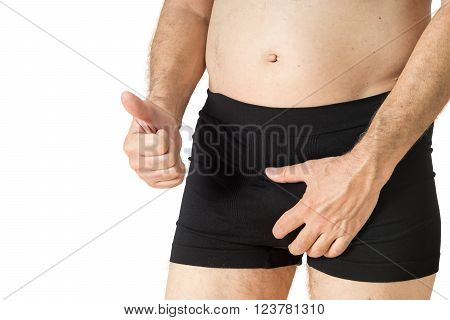Old Man Looking In His Boxer Underwear And Showing Thumb Up