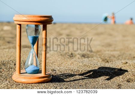 Photo Picture of Hourglass Clock on the Sand Beach