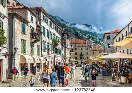 KOTOR MONTENEGRO - JUNE 18: People walking on old town street at sunny day at June 18 2014 in Kotor Montenegro