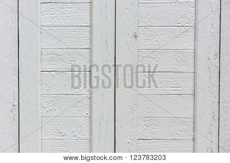 window with closed beige wooden shutters. background photo