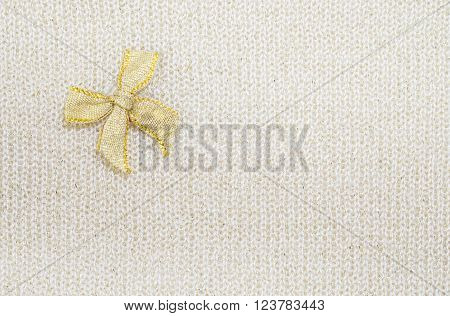 Gold ribbon on cream color fabric texture background