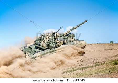 Omsk, Russia - July 07, 2011: International exhibition of high-tech equipment and weapons, tank on maneuvers, motion on hill