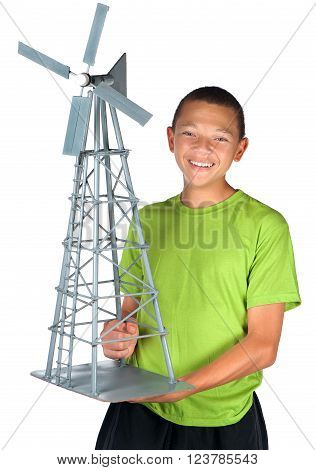 A smiling boy sports a model windmill he just completed.