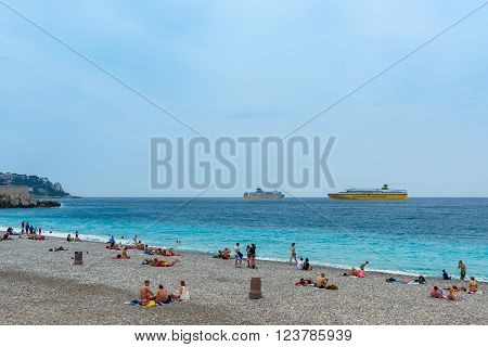 People On The Beach Of The Mediterranean Sea In Nice
