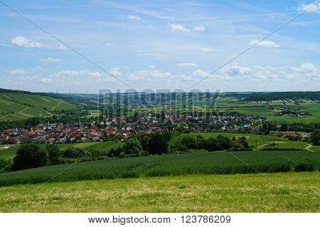 View of the rural, historic village of Markelsheim on a plain surrounded by green hills. Markelsheim, Taubertal, Franconia in Bavaria, Germany.