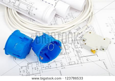 Architecture plan and rolls of blueprints with cable and blue plastic covers, closeup. Building concept