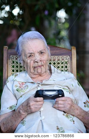 upset grandma with game joystick playing videogames