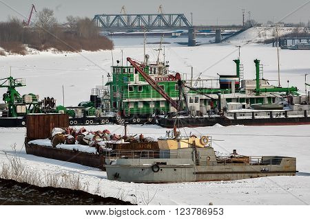 Tyumen, Russia - November 18. 2011: not self-propelled diesel electric refulyorny pump-dredge with a milling and hydraulic baking powder on winter parking