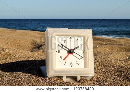 Closeup of a Clock on the Sand Beach