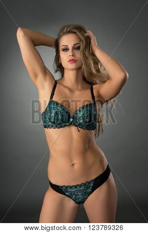 Studio photo of sensual model posing in erotic underwear