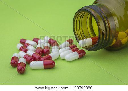 Pills spilling from an open bottle, healtcare concept