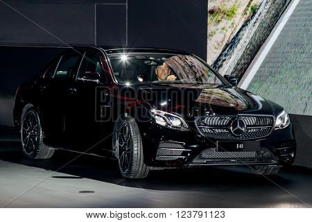 NEW YORK - March 23: A Mercedes E 43 with Dietmar Exler, president and chief executive officer of Mercedes-Benz USA LCC  exhibit at the 2016 New York International Auto Show during Press day.