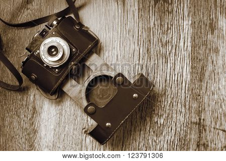vintage old film photo camera in sepia color