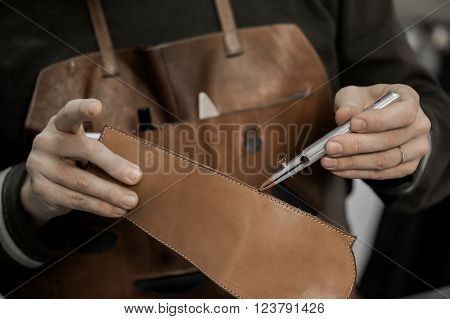 Trunk Maker at work in his luxury leather workshop, France