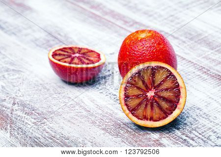 Sicilian orange isolated on a wood background