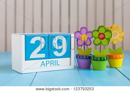 April 29th. Image of april 29 wooden color calendar on white background with flowers. Spring day, empty space for text. International or World Dance Day.