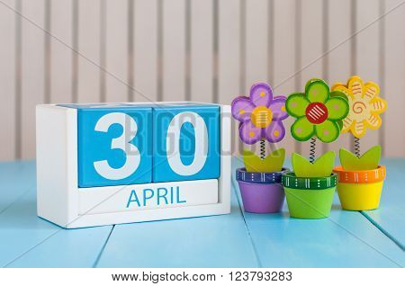 April 30th. Image of april 30 wooden color calendar on white background with flowers. End month. Spring day, empty space for text. International Jazz Day.