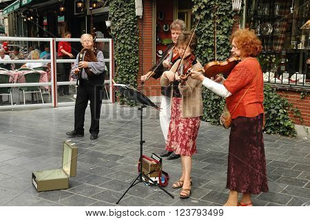 BELGIUM, ANTWERP - SEPTEMBER 01, 2005: Street musicians playing on a street