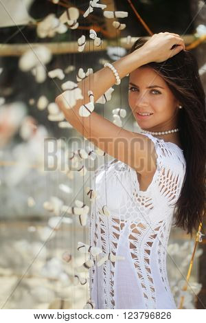 Beautiful young woman portrair with tropical seashells decoration
