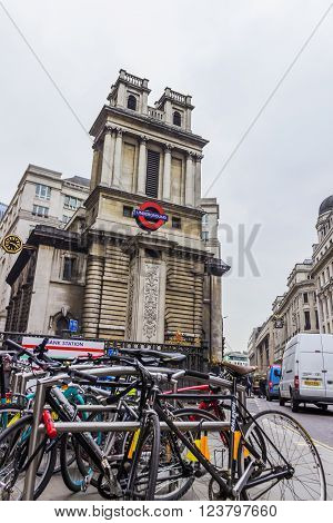 London, United Kingdom - March 23, 2016: Street view of Bank underground tube station and Saint Mary Woolnoth Church of England behind a row of bikes in London, United Kingdom on the 23rd of March 2016.