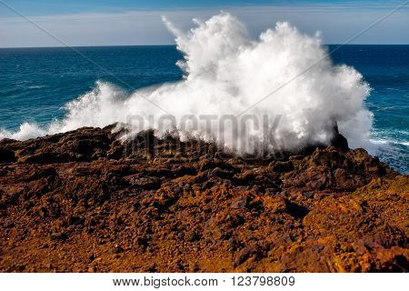 Huge ocean splash on the rocky Los Hervideros coast on Lanzarote island in Spain