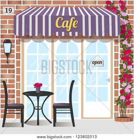 Cafe building facade of red brick. Table and chairs at the fore.   Climbing rose near the door. Vector illustration eps 10.