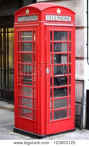 The typical London red telephone booth in London, UK