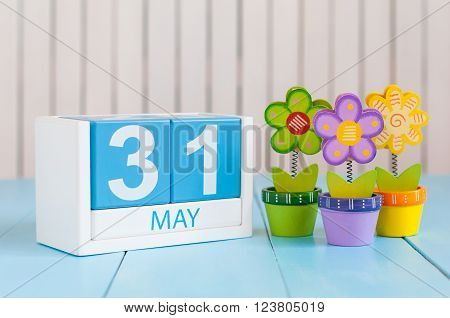 May 31st. Image of may 31 wooden color calendar on white background with flowers. Last spring day, Spring end. Empty space for text. World blondes Day.