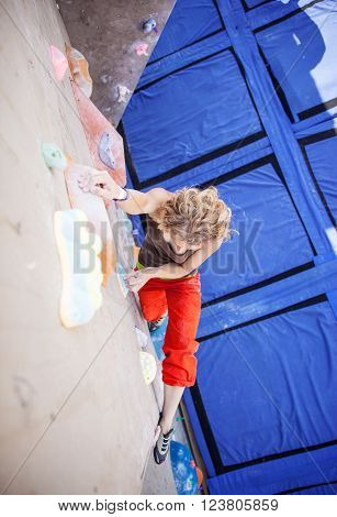 Young female climber on artificial climbing wall