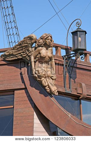 ST. PETERSBURG RUSSIA - JUNE 22 2008: Wooden statue of winged woman on restaurant on the ship