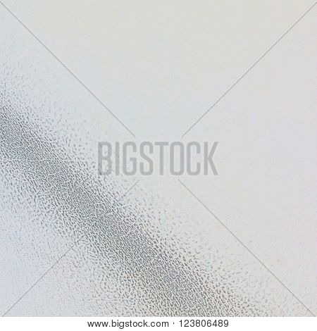 Neutral grey background with grainy texture wave in square format.