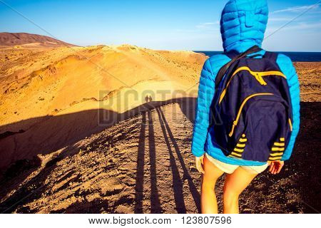 Femail tourist walking deserted landscape nnear Papagayo beach  on the south of Lanzarote island in Spain