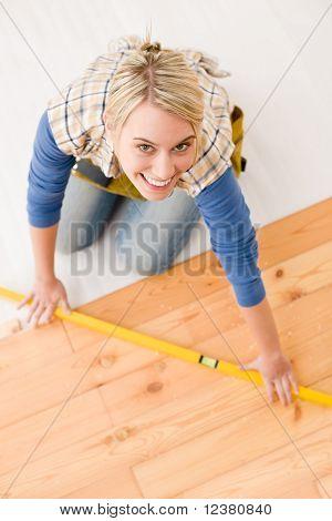 Home Improvement - Handywoman Installing Wooden Floor
