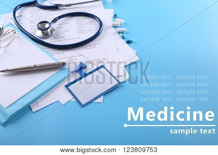 Medical supplies on blue background