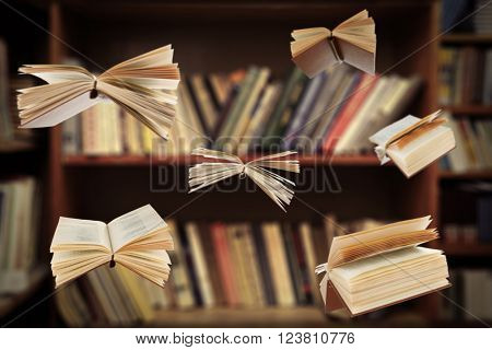 Flying open books in library