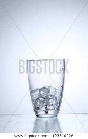glass of the ice on the white background
