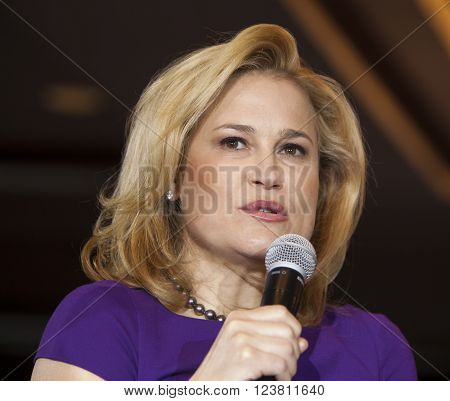MADISON WI/USA - March 28 2016: Heidi Cruz the wife of Republican presidential hopeful Ted Cruz speaks to a group of supporters during a rally in Madison Wisconsin.