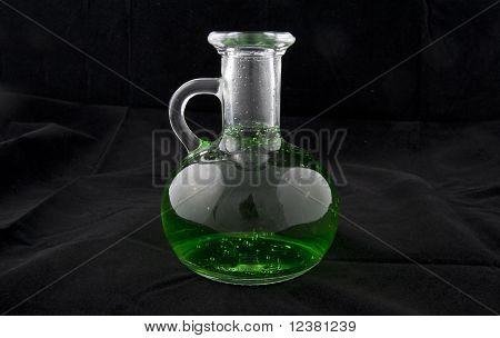 The Bottle Of Green Poison