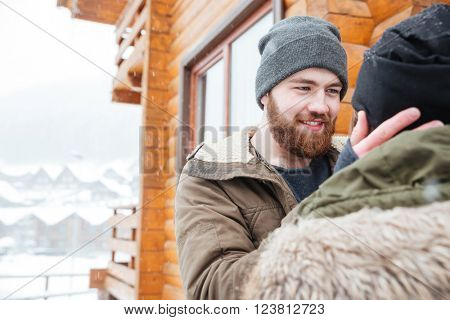 Tender happy couple standing and hugging outdoors in winter