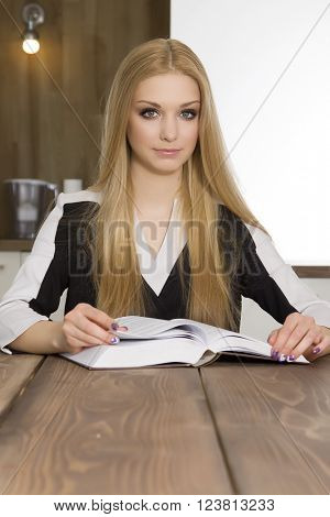 Portrait of beauty clever student reading book