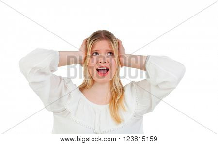 Blonde girl covering her ears isolated on a white background